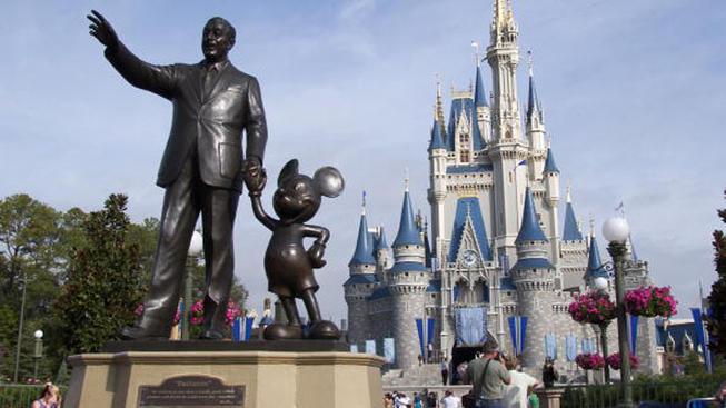 Magic Kingdom Castle with Walt & Disney statue closeup image